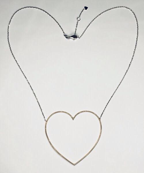 Collier in oro rosa e bianco 18 kt, linea cuore